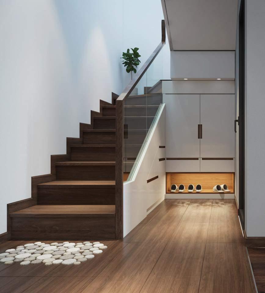 Trang trí gầm cầu thang giúp tiết kiệm diện tích cho phòng khách
