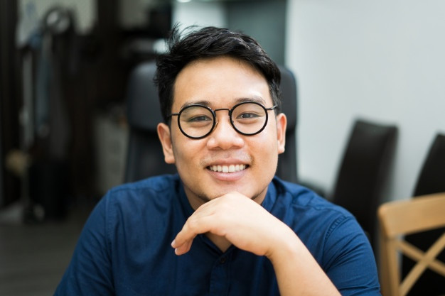 close-up-young-asian-man-wearing-glasses-208349-51